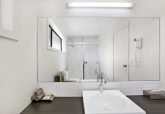 Enjoy the large shower with Rain Head luxury in a well-appointed large bathroom - Elm Tree Motel Warrnambool Vic